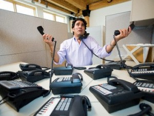 Office Worker Telephoning --- Image by © Royalty-Free/Corbis
